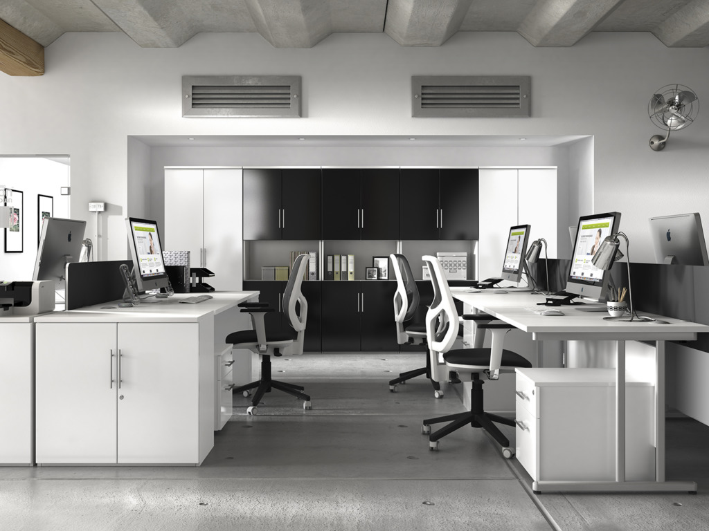 An empty office space with all of the office furniture.