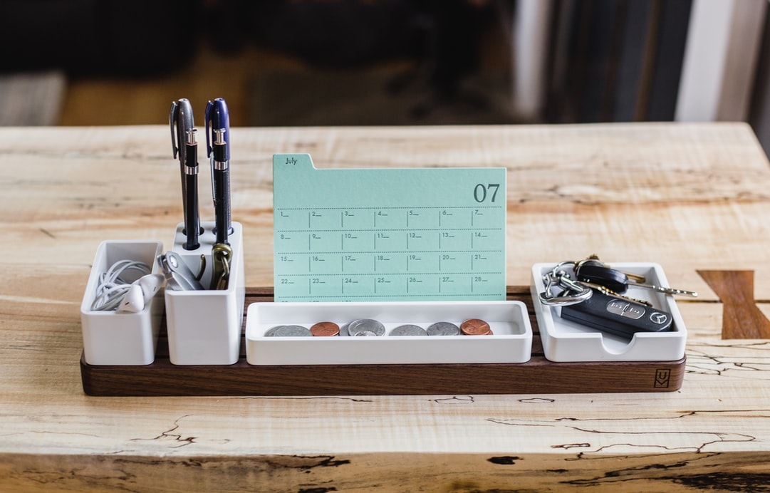 A desk organiser filled with office stationery.