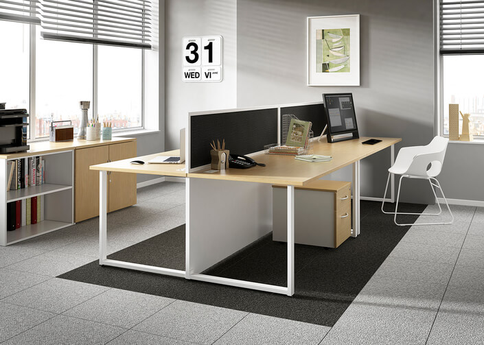 An office with back-to-back desks.