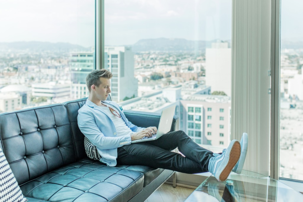 Man working from home on sofa