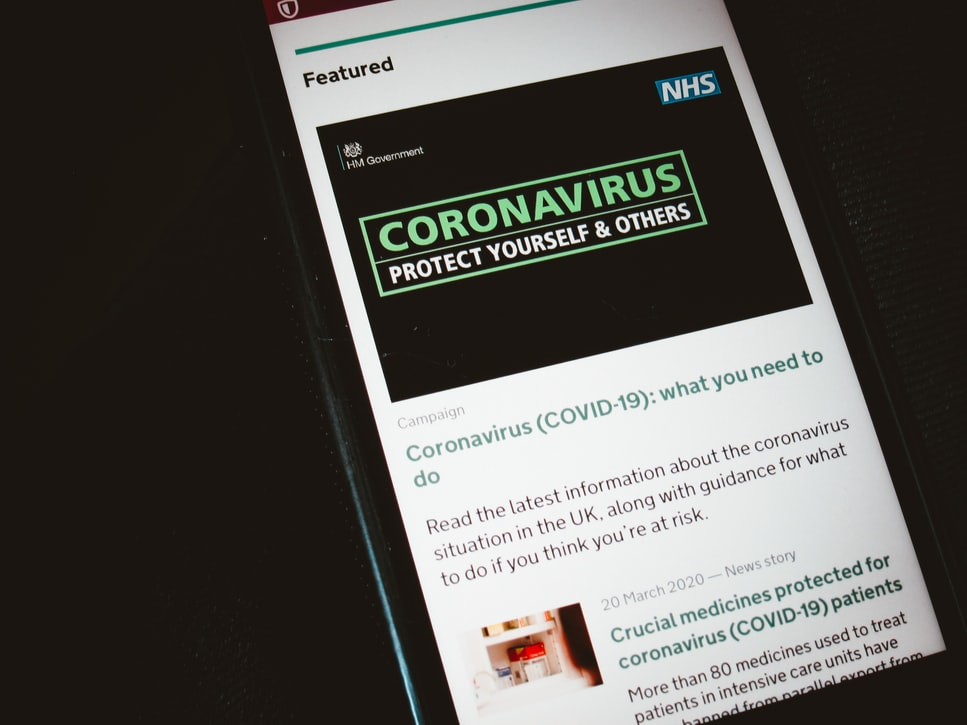 A mobile phone screen showing Covid-19 advice.